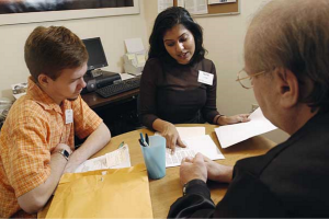 At the Elder Law Clinic in University Station, Law School students Nate Romano and Sejal Gandhi help with a legal issue.